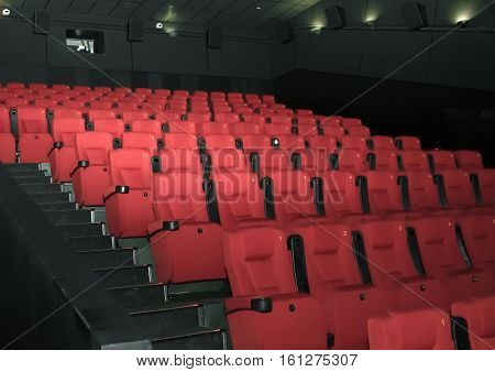 Empty comfortable red seats with numbers in moderncinema