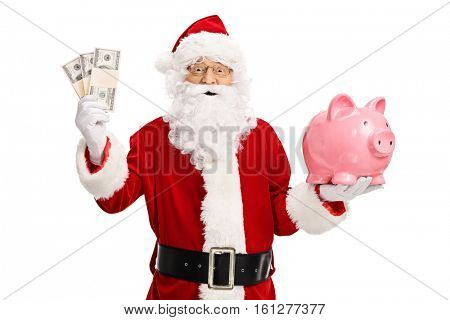 Santa claus holding money bundles and a piggybank isolated on white background