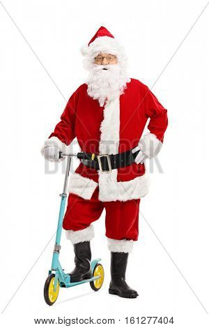 Full length portrait of santa claus posing with a scooter isolated on white background