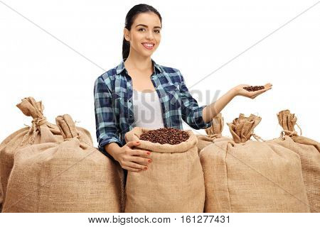 Female farmer with burlap sacks giving coffee beans isolated on white background