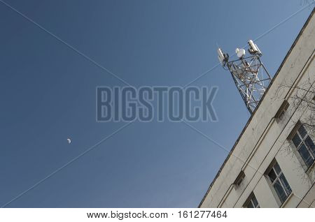 The cellular communication aerial on a building roof