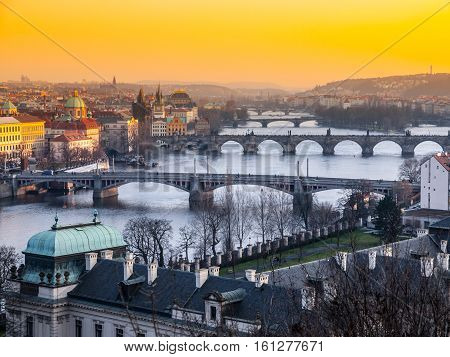 Prague bridges over Vltava River at sunset time. Cityscape panorama shot from Letna, Prague, capital city of Czech Republic, Europe. UNESCO World Herotage Site