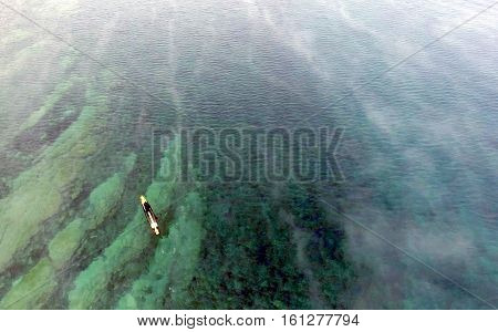Aerial view of a paddle boarder in Winter