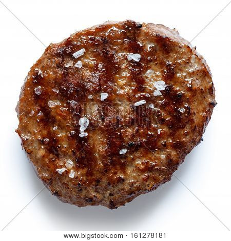 Single Grilled Hamburger Patty With Salt Isolated On White From Above.