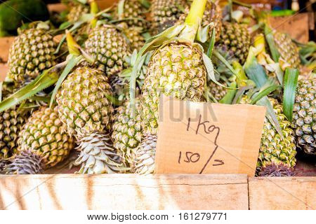 Bunch of ripe juicy pineapples at Sri Lankan market place