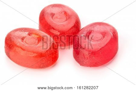 Three colorful fruit hard sugar candies,  boiled sweeties or sugar plums isolated on white background cutout