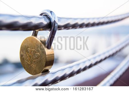 Wedding lock on a handrail. Symbol of marriage.