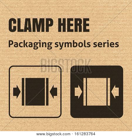 Clamp Here Packaging Symbol On A Corrugated Cardboard Background. For Use On Cardboard Boxes, Packag