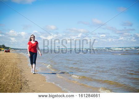 Girl Walking Near The Sea In Jurmala, Latvia