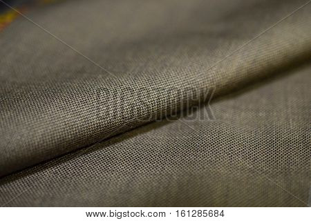 close up roll stripe gold fabric of suit photo shoot by depth of field for object