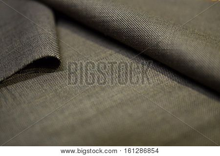 close up texture gold fabric of suit photo shoot by depth of field for object