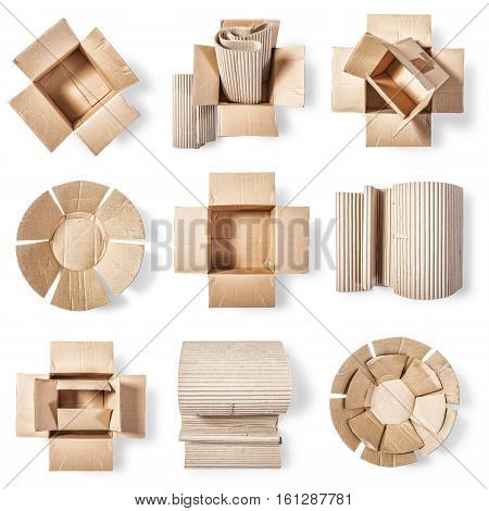 Open cardboard box corrugated role and paper plate. Packaging material collection. Objects group isolated on white background. Top view flat lay