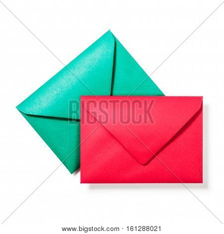 Green and red envelopes isolated on white background. Two objects with clipping path. Top view flat lay