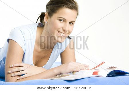 portrait of lying down woman with a journal