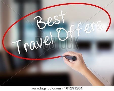 Woman Hand Writing Best Travel Offers  With A Marker Over Transparent Board