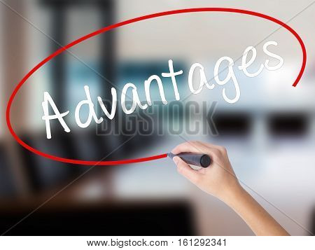 Woman Hand Writing Advantages With A Marker Over Transparent Board