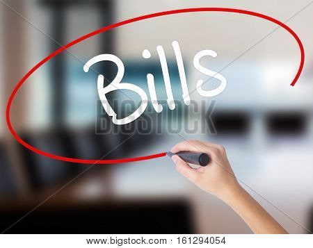 Woman Hand Writing Bills With A Marker Over Transparent Board