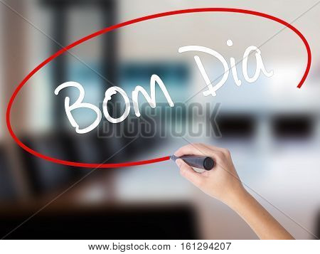 "Woman Hand Writing ""bom Dia"" (in Portuguese - Good Morning)  With A Marker Over Transparen"