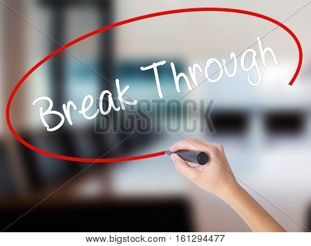 Woman Hand Writing Break Through With A Marker Over Transparent Board