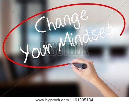 Woman Hand Writing Change Your Mindset With A Marker Over Transparent Board.