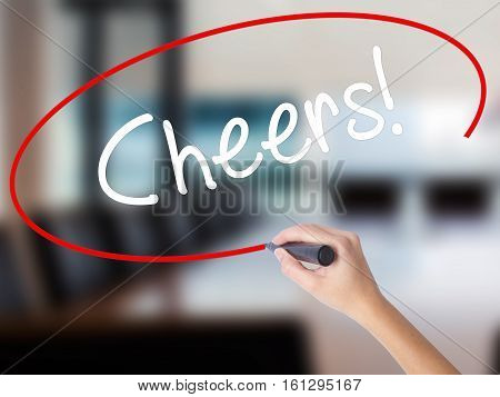 Woman Hand Writing Cheers! With A Marker Over Transparent Board