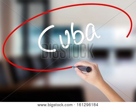 Woman Hand Writing Cuba With A Marker Over Transparent Board