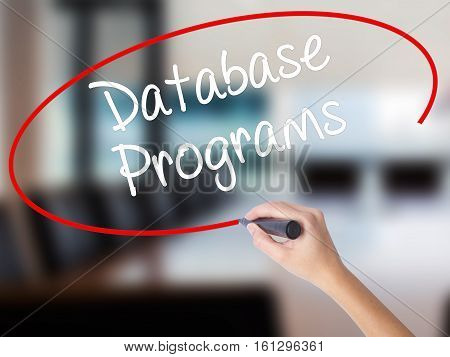 Woman Hand Writing Database Programs With A Marker Over Transparent Board.