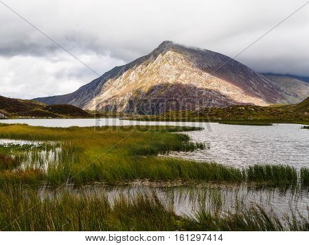 is a mountain in the Ogwen Valley, Snowdonia, Wales. It forms part of the Glyderau group, and is one of the most famous and recognisable peaks in Britain, having a classic pointed shape with rugged crags. At 917.5 m (3,010 ft) above sea level it is the fi