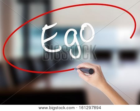 Woman Hand Writing Ego With A Marker Over Transparent Board