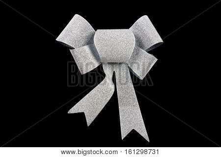 silver ribbon bow isolated on black background, studio shot