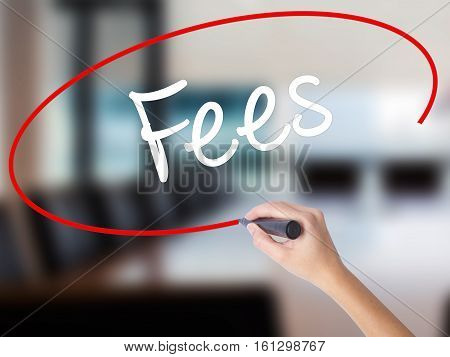 Woman Hand Writing Fees With A Marker Over Transparent Board