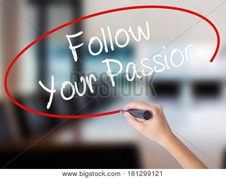 Woman Hand Writing  Follow Your Passion With A Marker Over Transparent Board