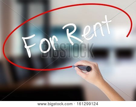 Woman Hand Writing For Rent With A Marker Over Transparent Board