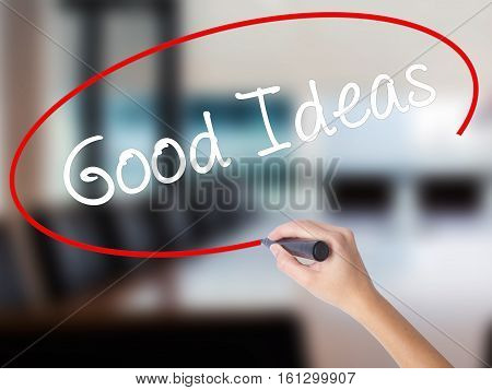 Woman Hand Writing Good Ideas With A Marker Over Transparent Board.