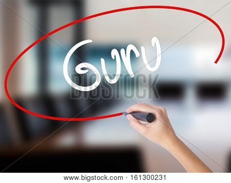 Woman Hand Writing Guru With A Marker Over Transparent Board