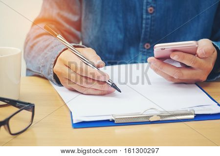 Business man Writing payments accounting work online