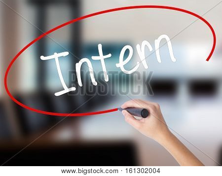 Woman Hand Writing Intern  With A Marker Over Transparent Board