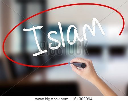 Woman Hand Writing Islam With A Marker Over Transparent Board