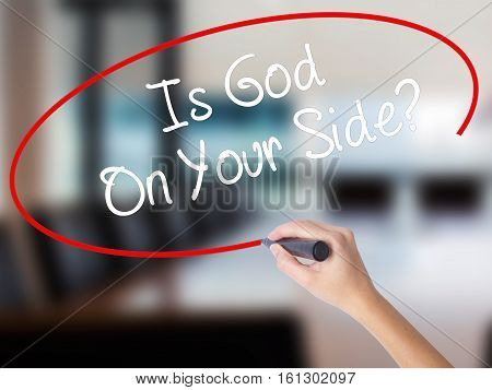 Woman Hand Writing Is God On Your Side? With Marker On Visual Screen