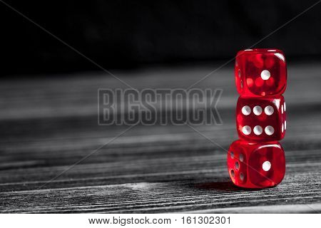 concept luck - dice gambling on dark wooden background.