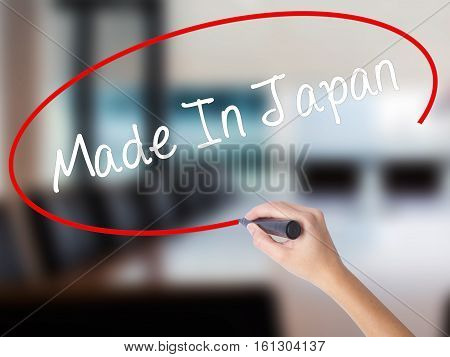 Woman Hand Writing Made In Japan With A Marker Over Transparent Board