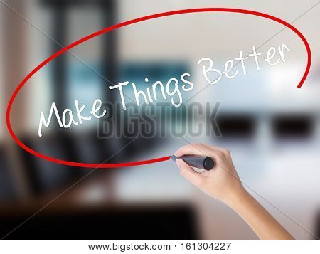 Woman Hand Writing   Make Things Better With A Marker Over Transparent Board