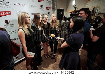 MOSCOW, RUSSIA - JUN 06, 2016: Music group Blestyashie gives interviews to journalists at the ceremony of awarding Fashion People Awards in hotel DoubleTree by Hilton Moscow - Marina.