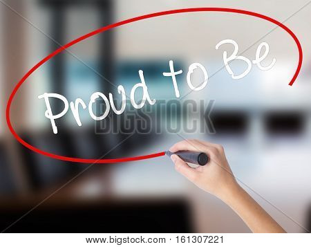 Woman Hand Writing Proud To Be With A Marker Over Transparent Board