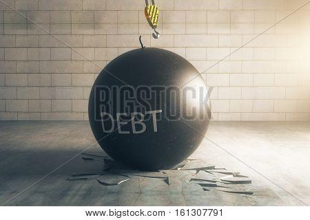 Debt concept. Wrecking ball with text in brick interior with broken floor. 3D Rendering