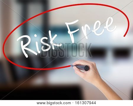Woman Hand Writing Risk Free With A Marker Over Transparent Board