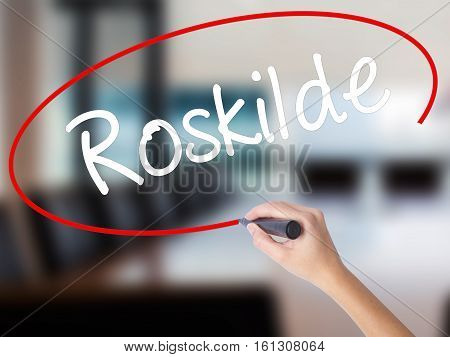 Woman Hand Writing Roskilde With A Marker Over Transparent Board