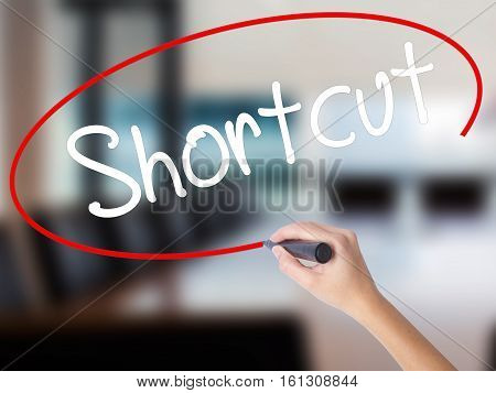 Woman Hand Writing Shortcut With A Marker Over Transparent Board