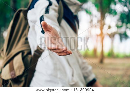 traveler with backpack walking in forest on holiday