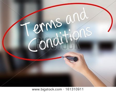 Woman Hand Writing Terms And Conditions With A Marker Over Transparent Board